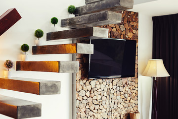 staircase and TV in luxury apartment interior