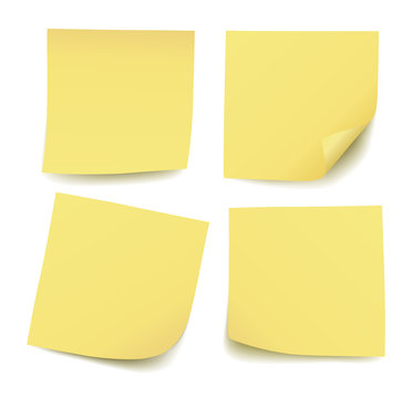 Set of four realistic blank vector yellow post it notes isolated on white background