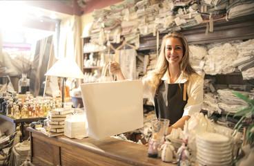Shop assistant handing over a bag