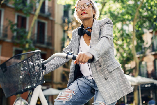 Low angle view of woman riding bicycle on street