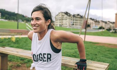 Happy woman exercising at park