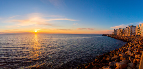 Panoramic view of the western harbour at sunset in Malmo from the swedish side over to Denmark