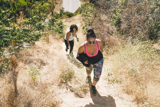 Female friends walking on mountain