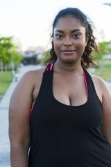 Portrait of confident sportswoman standing at park