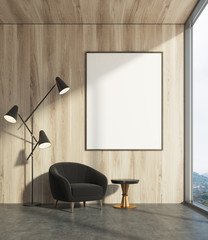 Wooden living room, black armchair, poster