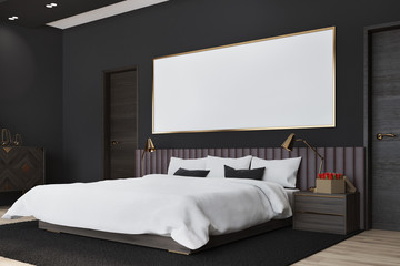 Black bedroom with a poster, side view