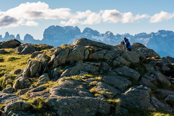 Female trekker on walking mountain ridge.