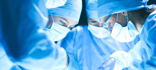 Team surgeon at work on operating in hospital