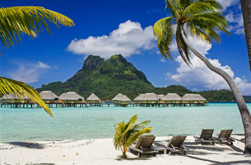 Bora Bora's Mount Otemanu looking down on above water hotel cabins