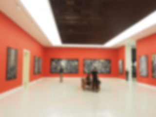 Abstract blur contemporary art gallery for background .Blur picture of art exhibition art gallery.