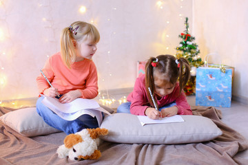 Little girls in anticipation of New Year's holidays make wishes