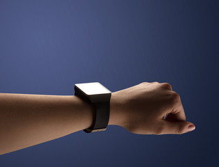 Close up female hand with balck smartwatch screen