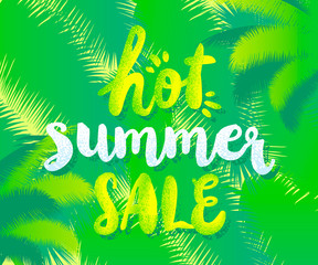 "Banner template with ""Hot summer sale"" quote on green background with leaves of a palm tree."