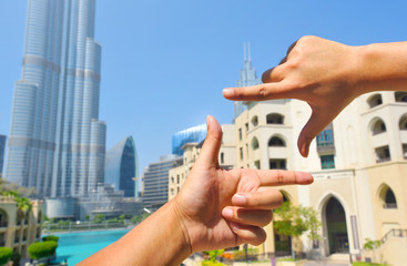 finger hand symbols concept framing composition for taking a photo Viewfinder with dubai downtown background