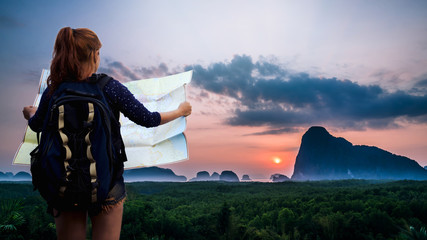 Asian women view travel map. archipelago Andaman sea Morning atmosphere Sun rises. Asia Thailand
