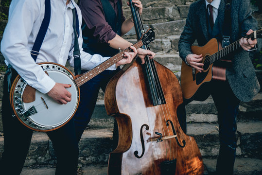Trio of musicians with a guitar, banjo and contrabass