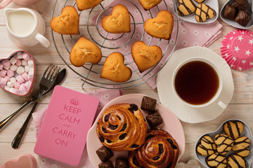 Flat lay cakes and cookies, muffins and rolls, biscuits and sweets, tea and coffee with marshmallow.