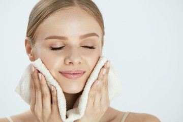 Woman Cleaning Face Skin With White Towel