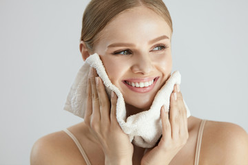 Face Washing. Happy Woman Drying Skin With Towel