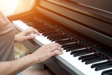 Close up female hands on chord piano