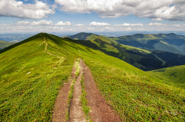 footpath on top of a mountain ridge in summer