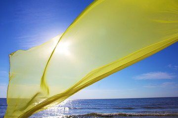 yellow tissue flying over the sea
