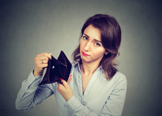 Woman with no money. Businesswoman holding empty wallet