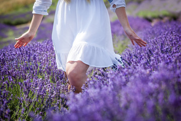 Hippie girl walking in lavender field, freedom concept