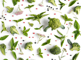 Fototapete - Green basil leaves and broccoli on white background. Vegetables pattern. Floral and vegetables on white background. Top view, flat lay.