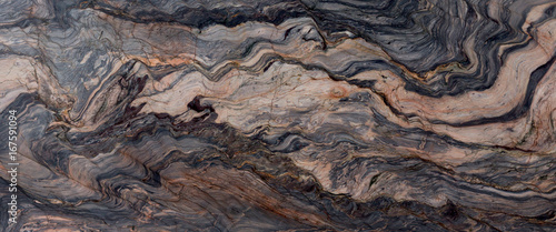 Wall mural Brown stone or rock background and texture.