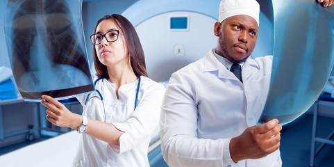 Doctors attentively examines the MRI scan of the patient.