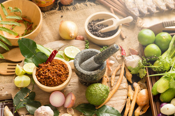 Assortment of Thai food Cooking ingredients. Spices ingredients chilli pepper garlicgalanga and kaffir lime leaves