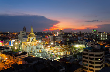 Top view of Bangkok cityscape,Wat Trimitr in chinatown or yaowarat area in Bangkok city, Bangkok, Thailand.