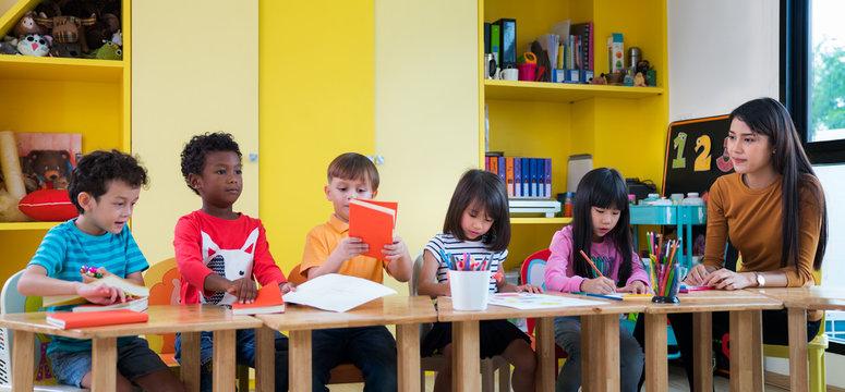 Asian teacher teach in international preschool