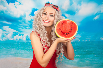 beautiful blonde young woman wearing red swim suit with watermelon on the beach