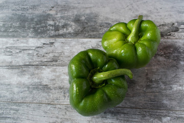 top view green bell peppers in rustic setting