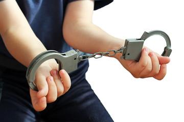 Handcuffs on children's hands, a toy