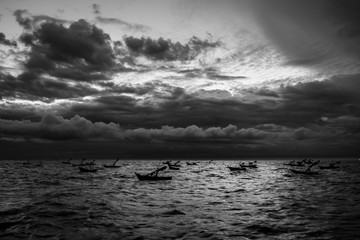 abstract black and white high contrasted horror seascape with fishing boats