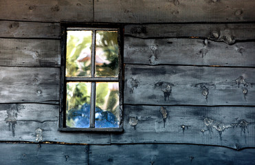 Old boarded wooden windows in wooden wall