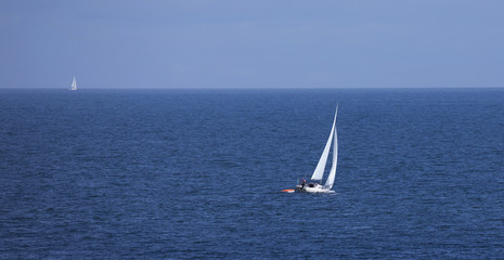 Sailboat on blue sea