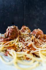 spaghetti and meatballs closup dark background