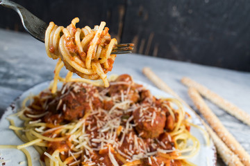Closeup of fork with spaghetti and meatballs