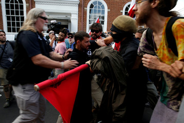 White supremacists clash with counter protesters during a rally in Charlottesville, Virginia