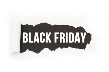 """Isolated inscription """"Black Friday"""" on a black background, paper rupture."""