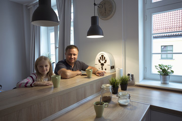 happy family is drinking tea