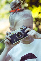 little pretty girl with retro camera