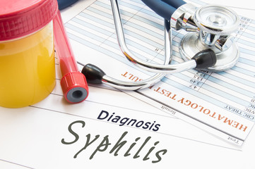 Diagnosis Syphilis. Stethoscope, lab test tube with blood, container with urine and result of blood laboratory analysis are near doctor's opinion diagnosis of STDs disease Syphilis