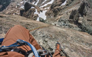 Foto op Aluminium Alpinisme Rock Climber Rappels in Mountainous Terrain in Washington State