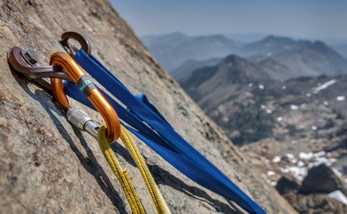 Fotorolgordijn Alpinisme Rock Climbing Anchor and Bolts with Mountain Vista