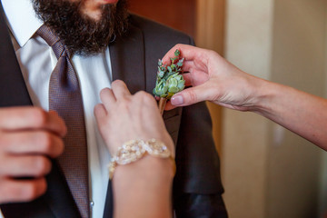 the bride wears a groom boutonniere